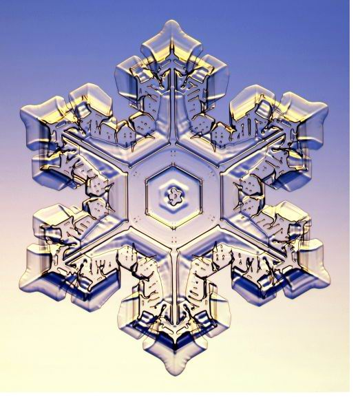 An image of a single, beautiful, hexagonal snowflake…