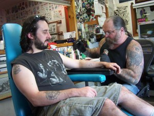 Getting Tat @ American Graffiti Tattoos in Brighton, MI; Chris Page doing the honors.